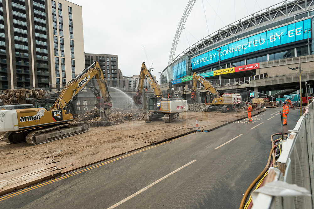 © Licensed to London News Pictures. 21/11/2020. LONDON, UK.  Work continues to demolish the iconic ramps on Wembley Way that lead up to Wembley Stadium. The ramps, known as pedways, have been used for 46 years by fans attending football matches and other events at the stadium. A new set of steps will replace them and be in place for 2021 at a cost of £18m.  Photo credit: Stephen Chung/LNP