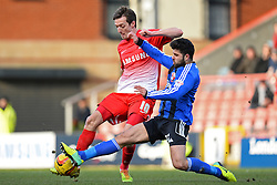 Orient's David Mooney and Swindon's Yaser Kasim compete for the ball - Photo mandatory by-line: Mitchell Gunn/JMP - Tel: Mobile: 07966 386802 22/02/2014 - SPORT - FOOTBALL - Brisbane Road - Leyton - Leyton Orient V Swindon Town - League One