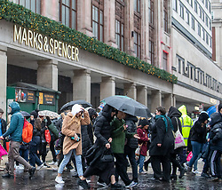 © Licensed to London News Pictures. File Picture 26/12/2019. Queues form outside M&S as Boxing Day bargain hunters brave the cold and the rain in Oxford Street for a chance to get large discounts on designer items. Alex Lentati/LNP