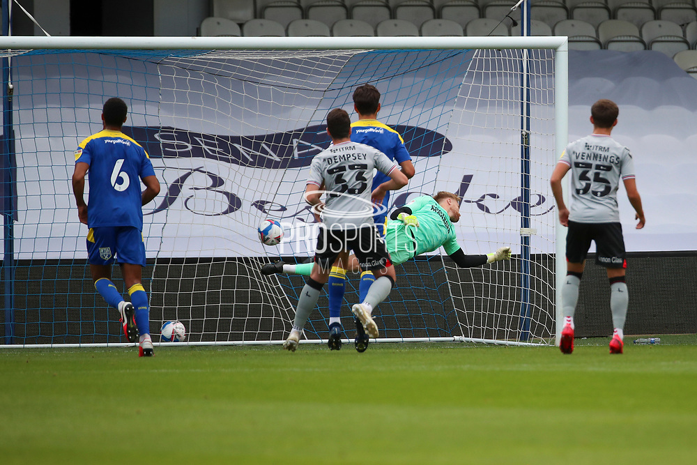 AFC Wimbledon goalkeeper Connal Trueman (1) is not able to  save Charlton GOAL 0-1 during the EFL Trophy Group O match between AFC Wimbledon and Charlton Athletic at the Kiyan Prince Foundation Stadium, London, England on 1 September 2020.