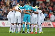 Swansea city players huddle together ahead of kick off. Premier league match, Swansea city v Manchester city at the Liberty Stadium in Swansea, South Wales on Saturday 24th September 2016.<br /> pic by Andrew Orchard, Andrew Orchard sports photography.
