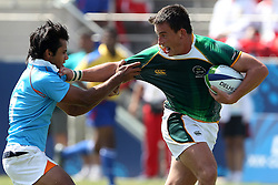 MJ Mentz fends off during the XIX Commonwealth Games 7s rugby match between South Africa and India held at The Delhi University in New Delhi, India on the  11 October 2010..Photo by:  Ron Gaunt/photosport.co.nz