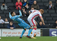 Football - 2017 / 2018 FA Cup - Fourth Round: Milton Keynes Dons vs. Coventry City<br /> <br /> Maxime Biamou (Coventry City) falls back after being challenged by Dean Lewington (MK Dons) at the Stadium MK.<br /> <br /> COLORSPORT/DANIEL BEARHAM