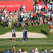 Ryder Cup 2016. Day One. Rory McIlroy of Europe celebrates with team mate Thomas Pieters after sinking the decisive putt on the sixteenth hole to put Europe back in contention in the Friday afternoon four-ball competition during the Ryder Cup at  Hazeltine National Golf Club on September 30, 2016 in Chaska, Minnesota.  (Photo by Tim Clayton/Corbis via Getty Images)
