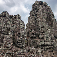 """Smiling faces of Avalokiteshvara in Bayon. According to """"Wikipedia"""" - The Bayon is a well-known and richly decorated Khmer temple at Angkor in Cambodia. Built in the late 12th century or early 13th century as the official state temple of the Mahayana Buddhist King Jayavarman VII, the Bayon stands at the centre of Jayavarman's capital, Angkor Thom. Following Jayavarman's death, it was modified and augmented by later Hindu and Theravada Buddhist kings in accordance with their own religious preferences."""