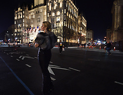 January 19, 2017 - Washington, DC, U.S - A woman stands in front of the Trump Hotel on her way to a ball on the eve of President Donald Trump's inauguration in Washington, D.C., on Jan. 19, 2017. (Credit Image: © Carol Guzy via ZUMA Wire)