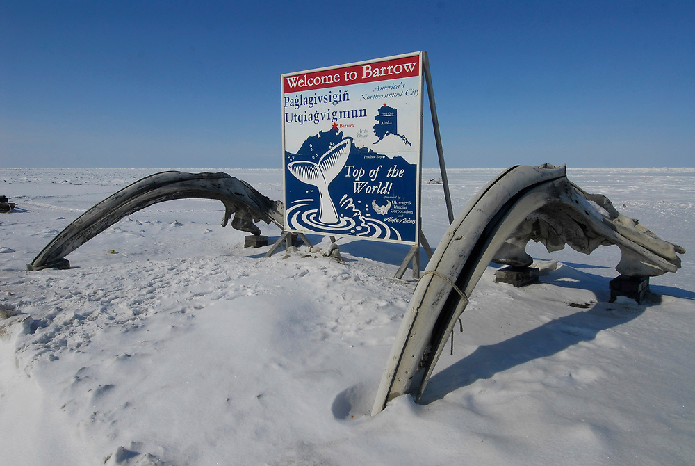 Alaska, Barrow. Wecome to Barrow sign at Browerville. There are two bowhead whale skulls by the sign.. Spring 2007