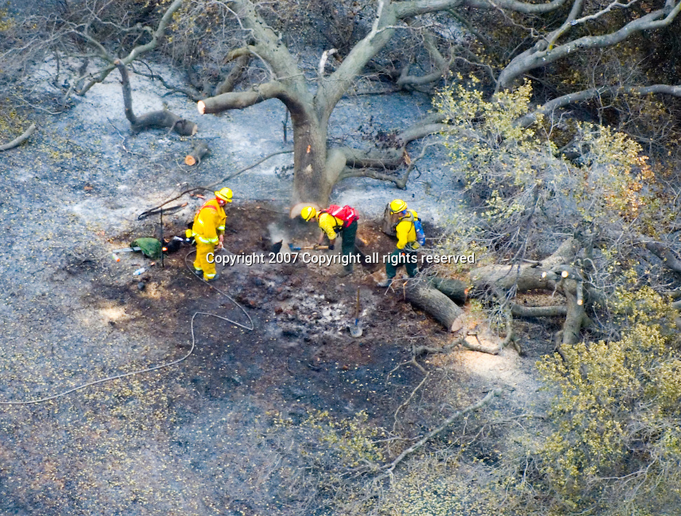 Aerial view of Firemen extinguishing hotspot at  Wildfire's on the California landscapes.