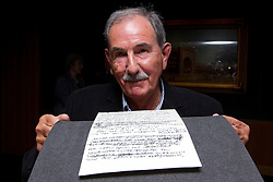 "© Licensed to London News Pictures. 22/05/2013. London, UK. Acclaimed Beatles biographer, Hunter Davies, is seen with the lyrics for the Beatles song 'She Said She Said' (1966) at the British Library in London today (22/05/2013).  The manuscript, along with others and letters between John Lennon and Mr Davies, have been donated to the library under the ""lifetime giving"" scheme. Photo credit: Matt Cetti-Roberts/LNP"