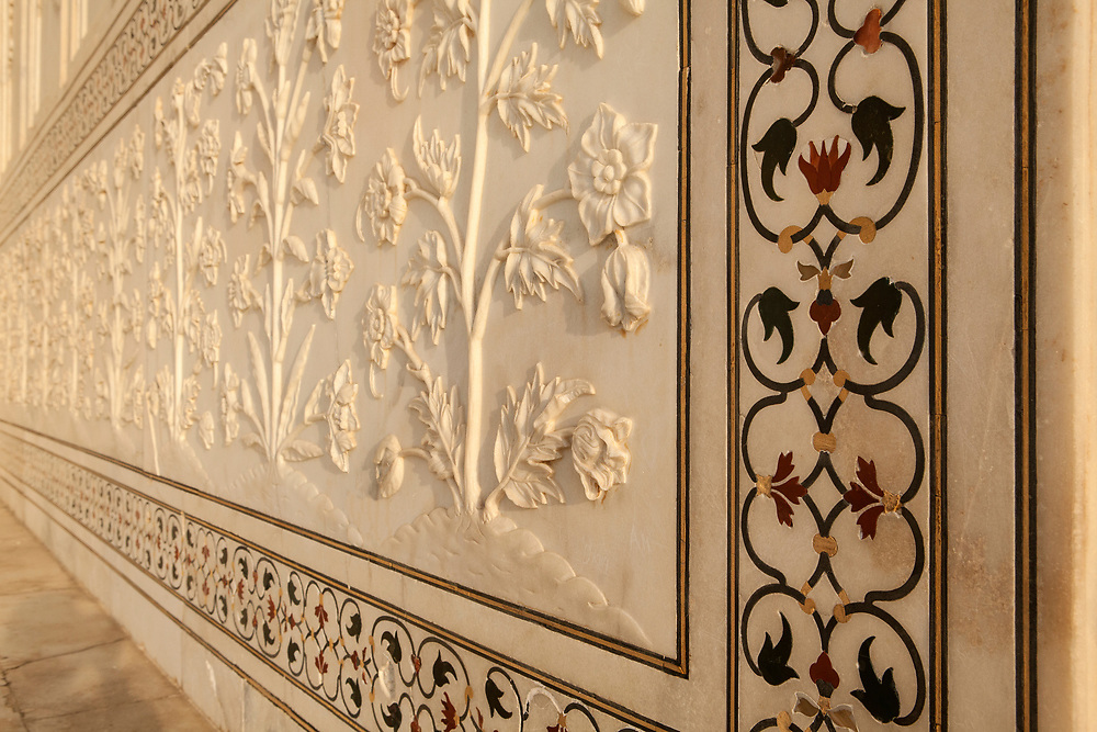 Marble carving detail at the Taj Mahal. It is an ivory-white marble mausoleum on the river Yamuna in the Indian city of Agra