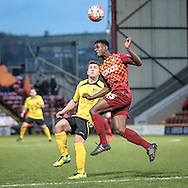 Greg Leigh (Bradford) gets a clearing header in during the The FA Cup match between Bradford City and Chesham FC at the Coral Windows Stadium, Bradford, England on 6 December 2015. Photo by Mark P Doherty.