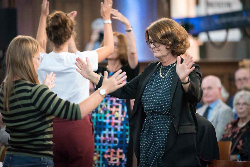 23 August 2018, Amsterdam, Netherlands: Youth participants lead a moment of prayer, through a dramatic choreography inviting gestures in interaction between the youth and other participants. Here to the right, Berit Hagen Ag¯y, Church of Norway. Hundreds of people gather from across the world for an ecumenical prayer service at the Nieuwe Kerk, a 15th-century church in Amsterdam, to celebrate the 70th anniversary of the World Council of Churches at the very spot in which the organization was founded. Under the theme ìWalking, Praying and Working Together,î pilgrims from all over the world attend the service.