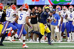 Michigan Wolverines quarterback Shea Patterson #2 runs the ball during the Chick-fil-A Peach Bowl, Saturday, December 29, 2018, in Atlanta. ( Paul Abell via Abell Images for Chick-fil-A Peach Bowl)