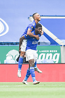 LEICESTER, ENGLAND - JULY 04: Youri Tielemans of Leicester City celebrates by jumping on Kelechi Iheanacho of Leicester City after he scored the first goal during the Premier League match between Leicester City and Crystal Palace at The King Power Stadium on July 4, 2020 in Leicester, United Kingdom. Football Stadiums around Europe remain empty due to the Coronavirus Pandemic as Government social distancing laws prohibit fans inside venues resulting in all fixtures being played behind closed doors. (Photo by MB Media)