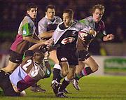 Photo Peter Spurrier<br />04/02/2003<br />Betfair Challenge Rugby - NEC  Harlequins vThe Sharks<br />Herkie Kruger, starts to loose his shirt from a tackle by Darryl Griffin, , The Stoop Memorial Ground, [Mandatory Credit: Peter Spurrier/Intersport Images],