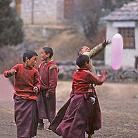 Young Buddhist monks play with a balloon at the old Tengboche Monastery in Nepal's Khumbu region.