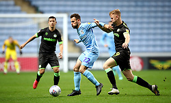 Forest Green's Nathan McGinley (right) and Coventry City's Tony Andreu (left) battle for the ball