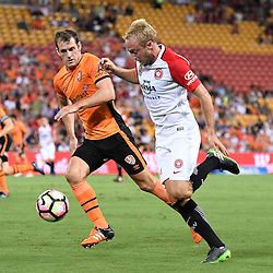 BRISBANE, AUSTRALIA - JANUARY 28: Mitch Nichols of the Wanderers and Luke DeVere of the Roar compete for the ball during the round 17 Hyundai A-League match between the Brisbane Roar and Western Sydney Wanderers at Suncorp Stadium on January 28, 2017 in Brisbane, Australia. (Photo by Patrick Kearney/Brisbane Roar)
