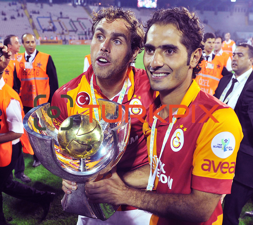 Galatasaray's players and Johan Elmander's (L) with Hamit Altintop celebrate with the trophy after their Turkish Super Cup 2012 soccer derby match Galatasaray between Fenerbahce at the Kazim Karabekir stadium in Erzurum Turkey on Sunday, 12 August 2012. Photo by TURKPIX