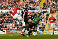 Photo: Leigh Quinnell.<br /> Bristol City v Nottingham Forest. Coca Cola League 1. 31/03/2007. Bristol City keeper Adriano Basso savesa shot from Forests Ian Breckin.
