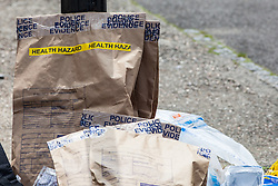 28/05/2016. London, UK. Police evidence bags await collection after a boy was stabbed 'repeatedly' on Payne Street in Deptford, south London, shortly after midnight on Saturday 28 May 2016. The 16-year-old victim is said to be 'critical', and a police cordon remains in place as investigations continue. Photo credit: Rob Pinney