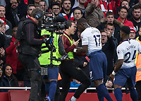 Football - 2018 / 2019 Premier League - Arsenal vs. Tottenham Hotspur<br /> <br /> Moussa Sissoko (Tottenham FC)  appears to lead in with his head as he confronts Stephan Lichtsteiner (Arsenal FC) at The Emirates.<br /> <br /> COLORSPORT/DANIEL BEARHAM