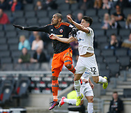 Leon Clarke of Sheffield Utd in action with George Williams of MK Dons during the English League One match at  Stadium MK, Milton Keynes. Picture date: April 22nd 2017. Pic credit should read: Simon Bellis/Sportimage