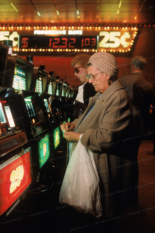 Women playing the slot machines at The Trump Plaza Casino in Atlantic City, New Jersey.