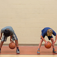 060613       Brian Leddy<br /> Brentley Tsosie, left, and Aidan Hollebeek practice a dribbling exercise Thursday at the Rehoboth Basketball Camp.