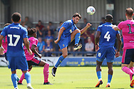AFC Wimbledon defender Will Nightingale (5) clearing the ball during the Pre-Season Friendly match between AFC Wimbledon and Queens Park Rangers at the Cherry Red Records Stadium, Kingston, England on 14 July 2018. Picture by Matthew Redman.