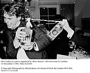 Clive Cooke at a party organised by Oliver Baxter. 149 Grosvenor St. London. 13 November 11981. Film. 81245f3<br />© Copyright Photograph by Dafydd Jones. 66 Stockwell Park Rd. London SW9 0DA. Tel 0171 733 0108