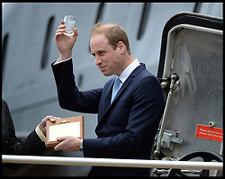 In the image - The Duke of Cambridge Prince William with a glass of rum given to him during his visit. <br /> The Duke of Cambridge Prince William, The Commodore-in-Chief Submarines, visits The Royal Navy Submarine Museum in Gosport, Hampshire, United Kingdom. Monday, 12th May 2014. Picture by Andrew Parsons / i-Images