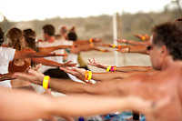 A group of fit people exercising during an outdoor yoga festival. Bhakti Fest is a Yoga | Dance | Music Festival which celebrates the devotional path that has its roots in yoga, kirtan, and meditation. It embraces ancient and modern sacred wisdom and traditional and non-traditional spiritual practices. The festival is a vehicle for evolution of human consciousness through a heart-centered revolution. Bhakti Fest builds a community of people drawn to follow the path of the heart – a devotional, prayerful, loving, healthful, respectful family. All the artists, presenters, and vendors embody, practice, and share the spirit of Bhakti through a variety of ways, including:<br /> Continuous Kirtan Music<br /> Yoga Classes<br /> Meditations and Prayer<br /> Teachings and workshops<br /> Fire Ceremonies (Pujas)<br /> Hanuman Chalisas<br /> Eco-Friendly, holistic market place<br /> Vegetarian, Vegan, and Raw Vegan Cuisine<br /> Wellness Sanctuary: massage, bodywork, energy work, intuitive readings, and other unique wellness enhancing modalities. Bhakti Fest is a Yoga | Dance | Music Festival which celebrates the devotional path that has its roots in yoga, kirtan, and meditation. It embraces ancient and modern sacred wisdom and traditional and non-traditional spiritual practices. The festival is a vehicle for evolution of human consciousness through a heart-centered revolution.