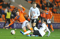 Blackpool's John Lundstram is tackled by Derby County's Omar Mascarell<br /> <br /> Photographer Dave Howarth/CameraSport<br /> <br /> Football - The Football League Sky Bet Championship - Blackpool v Derby County - Tuesday 21st October 2014 - Bloomfield Road - Blackpool<br /> <br /> © CameraSport - 43 Linden Ave. Countesthorpe. Leicester. England. LE8 5PG - Tel: +44 (0) 116 277 4147 - admin@camerasport.com - www.camerasport.com