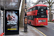 A government NHS National Heath Service ad at a Bus stop near the Royal Courts of Justice displays the face of a Covid patient, urging Londoners to stay at home and to socially distance, outside the Royal Courts of Justice, on 3rd February 2021, in London, England.