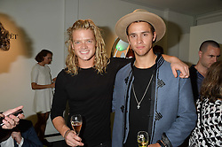 Left to right, FREDRIK FERRIER and JULIUS COWDRAY at the opening of L'Eden by Perrier-Jouet held at The Unit, 147 Wardour Street, Soho, London on 15th September 2016.
