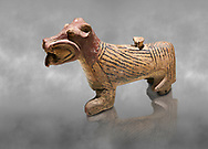 Hittite Terra cotta lion shaped ritual vessel - 16th century BC - Hattusa ( Bogazkoy ) - Museum of Anatolian Civilisations, Ankara, Turkey . Against grey art background .<br /> <br /> If you prefer to buy from our ALAMY STOCK LIBRARY page at https://www.alamy.com/portfolio/paul-williams-funkystock/hittite-art-antiquities.html  - Type Hattusa into the LOWER SEARCH WITHIN GALLERY box. Refine search by adding background colour, place, museum etc<br /> <br /> Visit our HITTITE PHOTO COLLECTIONS for more photos to download or buy as wall art prints https://funkystock.photoshelter.com/gallery-collection/The-Hittites-Art-Artefacts-Antiquities-Historic-Sites-Pictures-Images-of/C0000NUBSMhSc3Oo