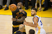 Cleveland Cavaliers forward LeBron James (23) passes the ball against Golden State Warriors guard Stephen Curry (30) during Game 5 of the NBA Finals at Oracle Arena in Oakland, Calif., on June 12, 2017. (Stan Olszewski/Special to S.F. Examiner)
