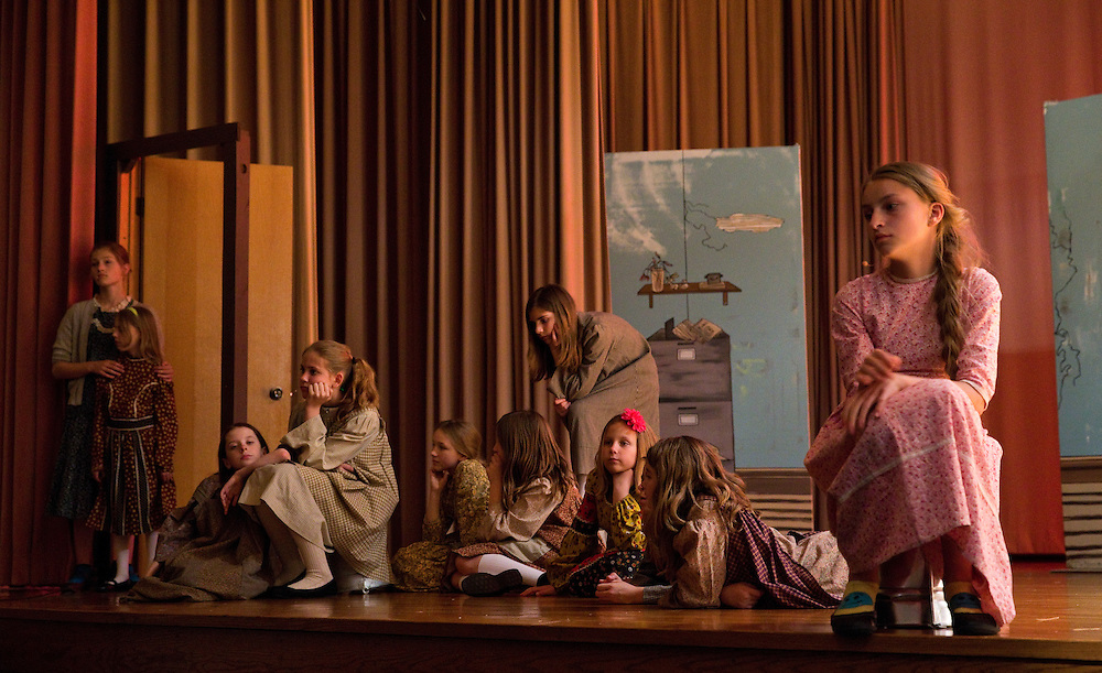 """Orphans listen to Annie's appearance on the radio in a scene during dress rehearsal for Grand Island Little Theatre's production of the musical """"Annie"""" Wednesday at College Park Auditorium. Showtimes are tonight at 7:30 p.m. at College Park Auditorium; Saturday, 7:30 p.m.; Sunday, at 2 p.m.; May 2 and 3, at 7:30 p.m. and May 4 at 2 p.m. Tickets are $15 per person and can be purchased at the door as well as Ace Hardware and Garden Center, Skagway North and South, Hy-Vee, or by calling the Grand Island Little Theatre box office at 308-382-2586. (Independent/Matt Dixon)"""