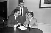 22/10/1963<br /> 10/22/1963<br /> 22 October 1963<br /> Italian order for Gilbey's. Pictured at the meeting where the order for Gilbey's ports was made official were Mr. D. Dand (Gilbey's) shows some the brands to Ugo Ciranni (seated) and Joseph Marion Piccioni (standing) at Gilbey's offices at Nos. 46-49 O'Connell St., Dublin. Accordo commerciale con la Gilbey's.