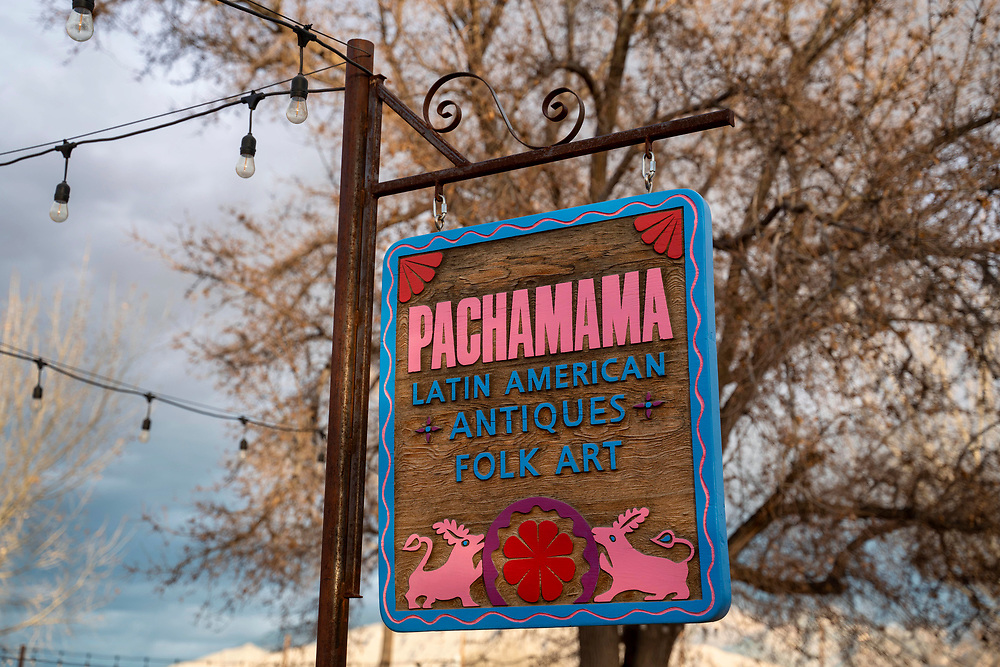 Detail of the sign for Pachamama shop at Casa Perea Art Space in Corrales,