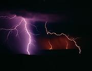Lightning striking ridges of the Sierra Ancha Mountains during the summer Monsoon season, Arizona.