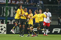 Photo: Chris Ratcliffe.<br /> Hamburg v Arsenal. UEFA Champions League, Group G. 13/09/2006.<br /> Gilberto of Arsenal (2nd from left) celebrates scoring the first goal.
