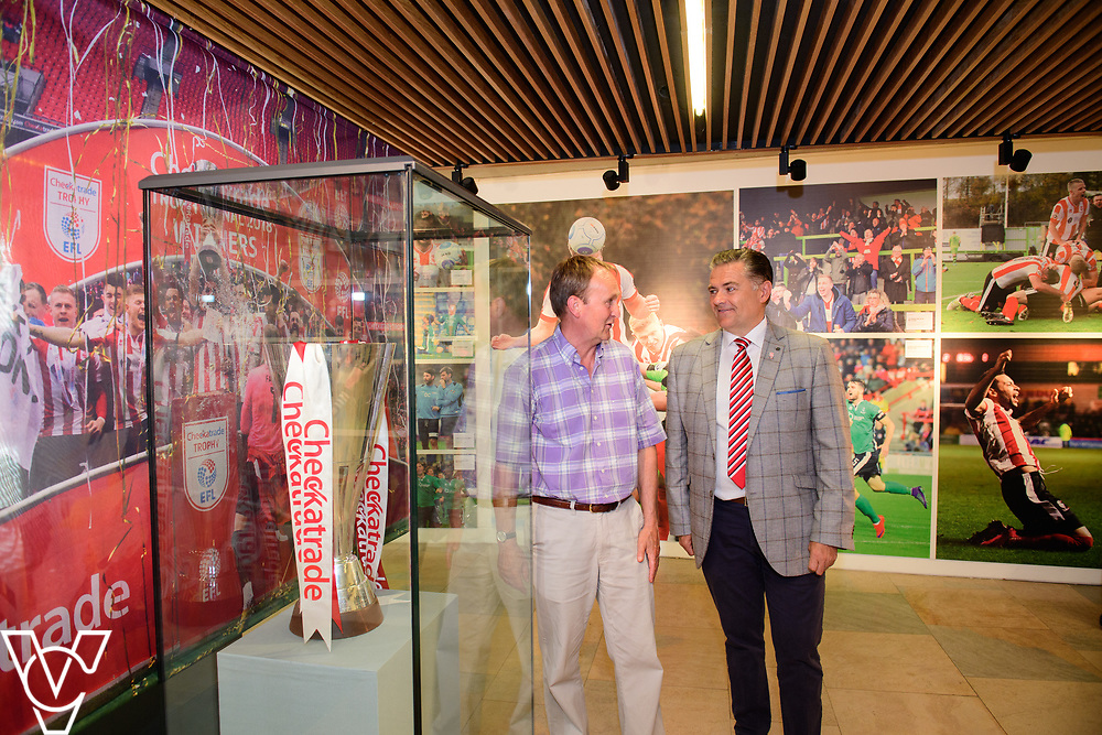 A special exhibition has launched at The Collection museum, in Lincoln. 'The Journey - a Celebration of Lincoln City FC 2016-18' celebrates two historic seasons for the Imps.  Pictured is, from left, Councillor Nick Worth, executive member for culture at Lincolnshire County Council and Lincoln City director Kevin Cook<br /> <br /> Picture: Chris Vaughan Photography<br /> Date: June 22, 2108