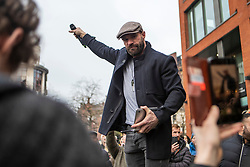 © Licensed to London News Pictures. 06/12/2020. Manchester, UK. Paul Boys, organiser of Rise Up protest in Manchester, speaks to the crowd, holding his mic up for the responding cheers in Piccadilly Gardens. Photo credit: Kerry Elsworth/LNP