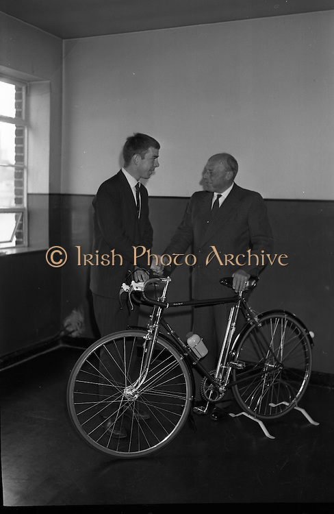 Seamus O'Hanlon, winner of Rás Tailteann, the annual eight day international cycling stage race.<br /> 1962. 14.08.1962. 08.14.1962. 14th August 1962.<br /> A presentation of a Raleigh 'Gran Sport' bicycle complete with Capagnolo 10 speed gear system was made to Seamus O'Hanlon, a twenty-year-old Dubliner, who won the Rás Tailteann this year. The presentation was made as he toured the Irish Raleigh Industries factory at Hanover Quay, Dublin.<br /> Image shows Mr Desmond Beatty, Managing Director, Irish Raleigh Industries, presenting the bicycle to Seamus O'Hanlon during his tour of the factory.