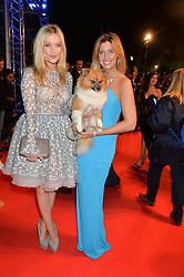 Left to right, LAURA WHITMORE and CHESKA HULL and her dog Eveie at Battersea Dogs & Cats Home's Collars & Coats Gala Ball held at Battersea Evolution, Battersea Park, London on30th October 2014.