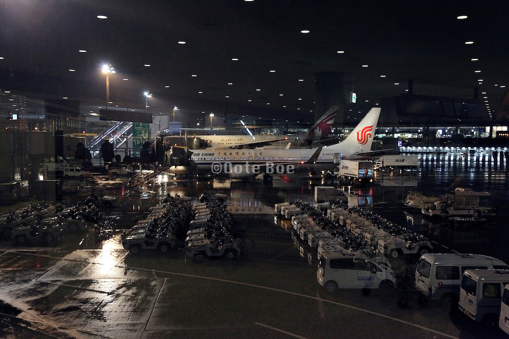 airplanes and cars parked during the night Narita airport Tokyo Japan