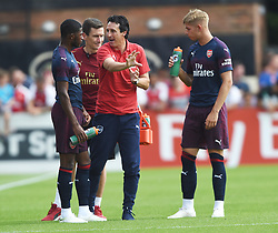 Arsenal manager Unai Emery gives instructions to Ainsley Maitland-Niles as Emile Smith Rowe looks on during the pre-season match at Meadow Park, Boreham Wood.