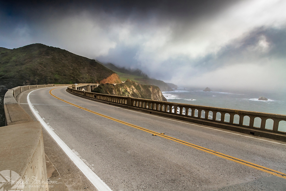 Bixby Bridge looking south to Hurricane Point, with dratic clouds on the Big Sur Coast, California Highway 1